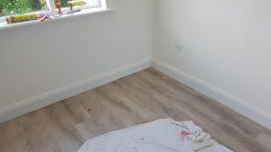 MDF skirting and oak laminate floor
