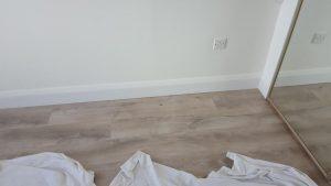 laminate oak floor with skirting greystones